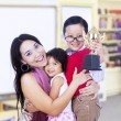 Boy champion and family in classroom — Stock Photo
