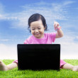 Royalty-Free Stock Photo: Happy girl learning computer