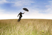 Flying insurance agent outdoor — Stock Photo