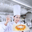 Beautiful chef and delicious pizza — Stock Photo #22142673