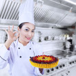 Beautiful chef cook delicious cake — Stock Photo