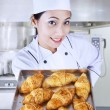 Chef holding croissants in kitchen — Stock Photo #22142907