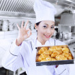 Happy baker with croissants — Stock Photo