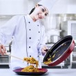 Asian chef cooks noodle — Stock Photo #22180607