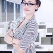 Confident businesswoman in office — Stock Photo #22181035