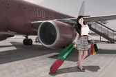 Affluent travel - beautiful woman arriving at airport — Stock Photo