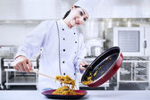 Asian chef cooks noodle — Stock Photo