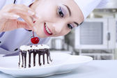 Attractive chef preparing dessert — Stock Photo