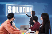 Reunión con la presentación de una solución de negocios — Foto de Stock