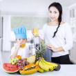 Healthy family having fruit juice at home - Stockfoto