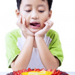 Little boy with fruit cake on white — Stock Photo #22645217