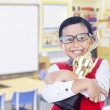Boy holds trophy at school — Stock Photo #22837098
