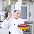 Chef holding delicious cake at work — ストック写真