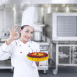 Chef holds delicious cake - horizontal — Stok fotoğraf