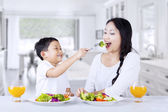 Eating green salad at home — Stock Photo