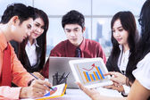 Asian business discussion at office — Stock Photo