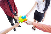 Business team building puzzle — Stock Photo