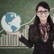 Businesswoman hold global profit - Stock Photo