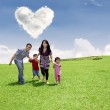 Family running in the park — Stock Photo