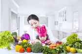 Asian mother teach daughter cook at home — Stock Photo
