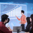 Business presentation with touchscreen chart — Stockfoto