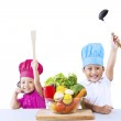 Happy chef kids with vegetable — Stock Photo #23691297
