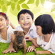 Children play time with dog in spring — Stock Photo