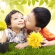 Brother kiss sister in park — Stock Photo
