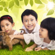 Three siblings and dog in park — Stock Photo