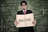 Businessman holding book of success — Stock Photo
