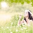Beautiful woman blowing bubbles — Stock Photo #23939759