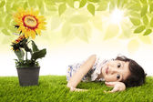 Cute girl and sunflower — Stock Photo