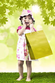 Excited girl and shopping bag — Stock Photo