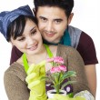 Asian couple holding a plant - isolated — ストック写真