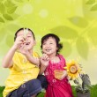 Cute siblings blowing bubbles — Stock Photo