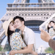 Stock Photo: Paris eiffel tower romantic couple kissing