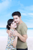 Portrait of young romantic couple on the beach — Stock Photo