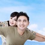 Happy girlfriend enjoy piggyback ride — Stock Photo