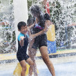 Family having fun in water park — Stock Photo