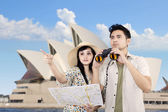 Asian couple using binoculars in Sydney, Australia — Stock Photo