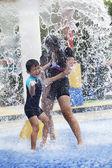 Family having fun in water park — Stock Photo