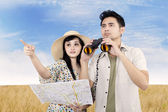 Girlfriend point direction of location — Stock Photo