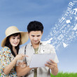 Stock Photo: Arrange honeymoon travel from electronic tablet