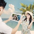 Couple take picture at beach — Stock Photo #24373341