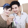 Happy couple hold keys at new home — Stock Photo #24373427