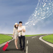 Couple search online for holiday destination — Stock Photo #24373459