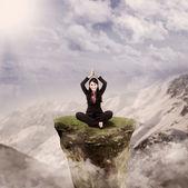 Happy businesswoman meditate on stone — Stock Photo