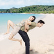 Romantic couple having a good time on the beach — Stock Photo