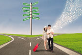 Couple travel at cross road using e-tablet — Stock Photo
