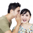 Boyfriend tell secret to girlfriend - isolated — Stock Photo